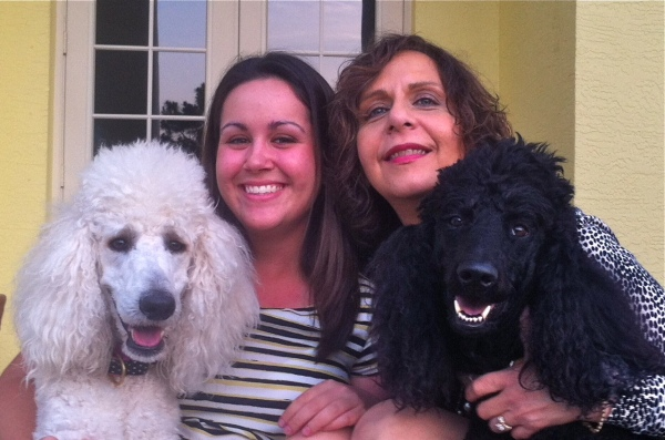 Magistrate Judette Fanelli with her daughter, Gia, and two rescued Poodles; Bella & Jake.
