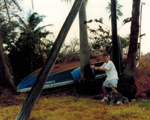 Eddie Stephens (with hair) surveying damage caused by Hurricane Andrew, August 28, 1992.