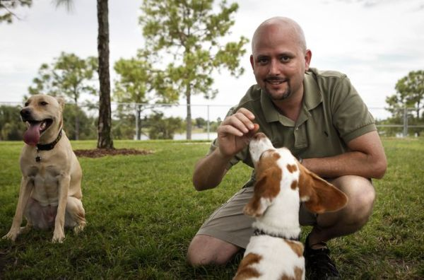 Eddie Stephens wirh his dogs Jack Henry and Abigail Sowflake at Okeeheelee Dog Park.