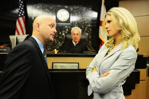 Attorneys Eddie Stephens and Cindy Crawford argue before the Honorable Charles Burton.